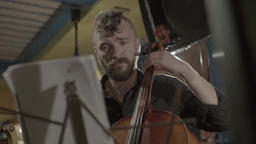 Male musician playing cello in the evening Footage