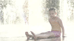 The girl in the fountain . Slow motion Footage