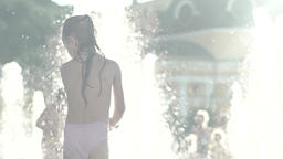Children in the fountain during the day. Summer. Slow motion Footage