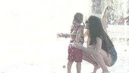 The girl and her mother in the fountain on a Sunny day. Slow motion Footage