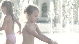 The girl in the fountain in summer . Slow motion Footage