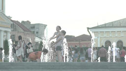 Children play in the fountain. Slow motion Footage