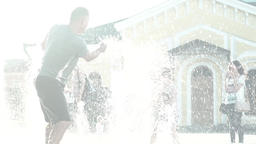 Happy childhood. Dad playing with daughter in the fountain . Slow motion Footage