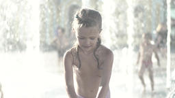 The girl in the fountain during the day . Slow motion Footage