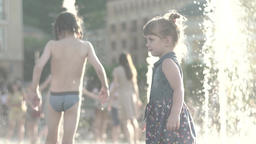 Children playing in the fountain in summer. Childhood . Slow motion Footage
