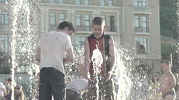 People in the fountain in summer . Slow motion Footage