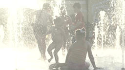 Children in the fountain in summer . Slow motion Footage