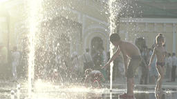 Children playing in the fountain with jets of water. Slow motion Footage