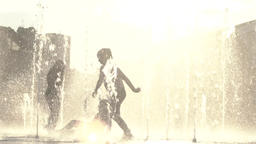 Many children play in the fountain. Childhood Footage