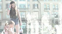 Girl with a balloon near the fountain in the summer Footage