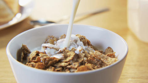 Pouring Milk into a Bowl with Muesli Footage
