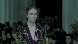 Girl model shows clothes at the fashion show . Slow motion Footage