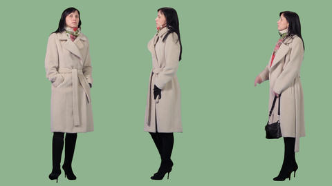 Elegant young woman stands in warm coat waits. Three clips at one price Footage