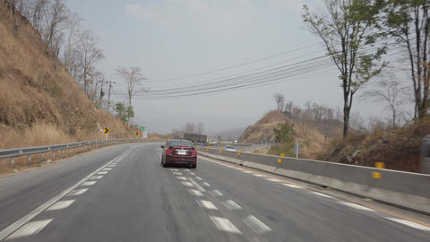 Driving along a mountine road while dry and smog season in Thailand. POV driving Live Action