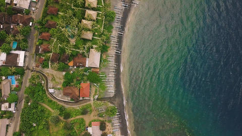 Top down view of exotic village and resort villas in serene seaside on summer Live Action