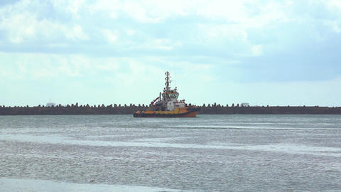 A patrol ship patrolling near a cargo seaport at daytime Live Action