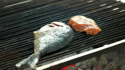Fish being cooked on grill dorado and salmon meat Live Action