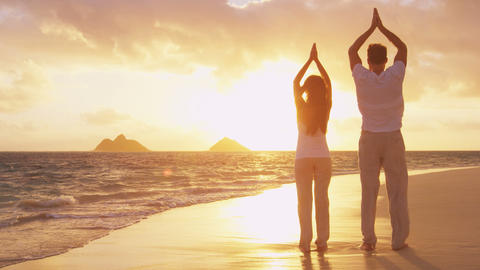 Yoga, fitness, sport, and wellness lifestyle concept on sunset beach Live Action