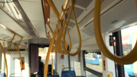 Hanging handrails in a bus. Plastic yellow grip on strap in public transport Live Action