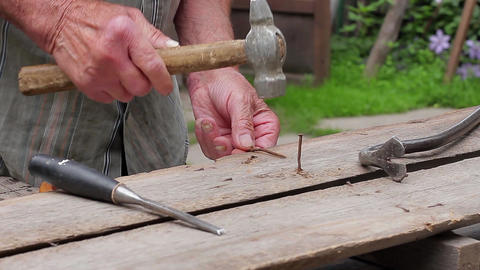 Old man hammering nails old hands to hammer nails Live Action
