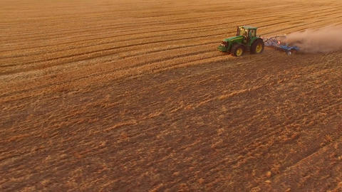 Tractor ploughing field rural economy development Live Action