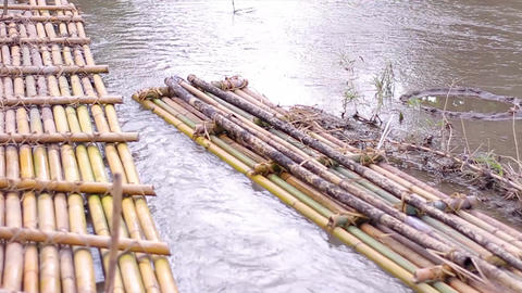 Mountain river in the jungle bamboo rafts tropical river Live Action