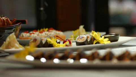White plates with sushi japanese food with decoration banquet Live Action