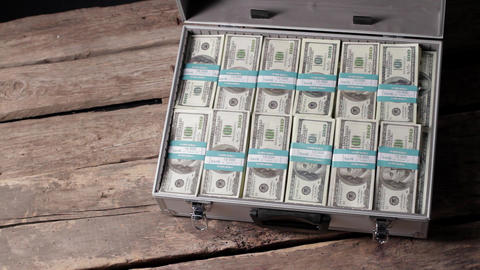 Hands opening case with dollars businessman opens suitcase Live Action