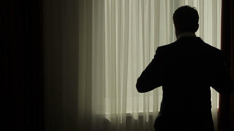 Business man puts on his jacket businessman dressed silhouette of a businessman Live Action