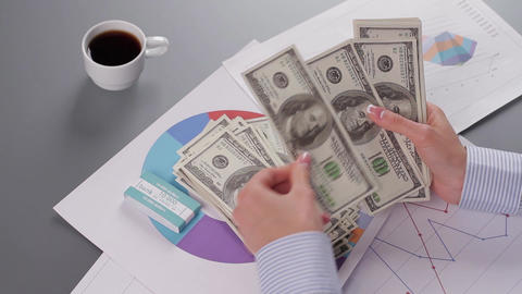 Chief financial officer counts profit business woman counts the money successful business project Live Action