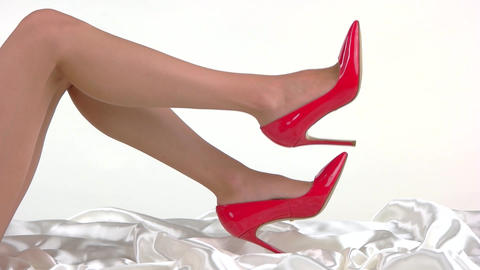 Bare legs wearing red heels ladys glossy footwear vogue Live Action