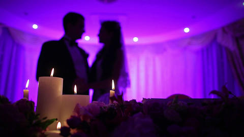Bride and groom kissing by candlelight romantic kiss of two lovers Live Action