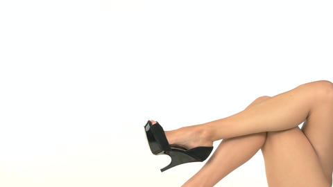 Isolated female leg in shoe dark footwear Live Action