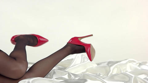 Legs in black tights glossy footwear on high heel vogue Live Action