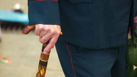 Old senior male hand with cane stick close up old world war veteran Live Action