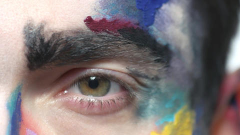 Scared eye close up face paint makeup macro the sense on fear Live Action
