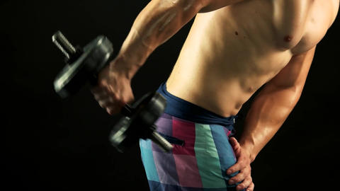 Athlete man exercising with dumbbells strong man Live Action