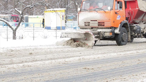Machine cleans snow roads was covered with snow snow on the highways Live Action