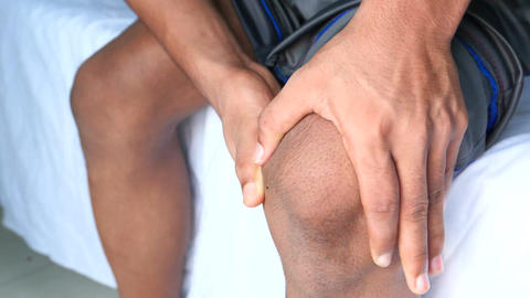 Close up on man suffering knee joint pain Live Action