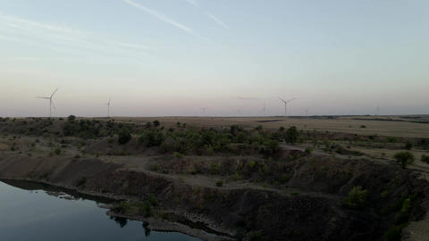 windmills farm, wind generators for energy production on sunset. Wind power Live Action