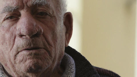 Elderly man speaking to the camera telling of his life Footage