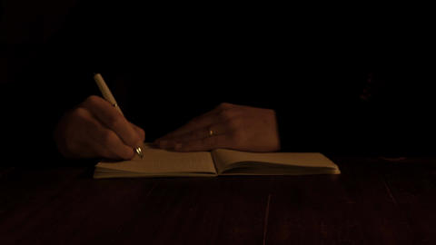 closeup on the hand of man sat alone wasting time drawing repetedly Footage