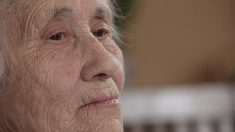 Wrinkled senior woman face Footage
