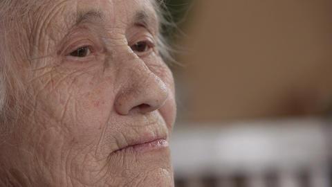 Wrinkled senior woman face Footage