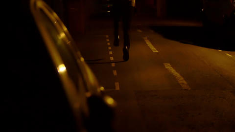 man victim of a thief try to follow him running along a dark and bad illuminated Live Action