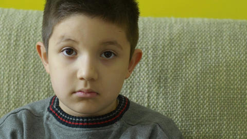 portrait of a young boy mouth closed, eyes opened Footage