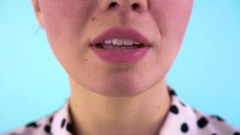 4K Closeup of a beautiful woman lips. Woman biting her beautiful lips. Close up Live Action