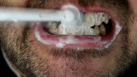 A Smoker Brushing His Teeth With An Electric Toothbrush Live Action