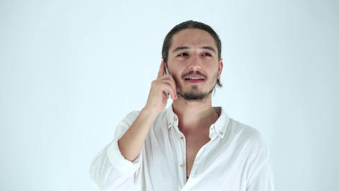 Portrait of handsome man talking on the phone. People, lifestyle, mobile communication concept Live Action
