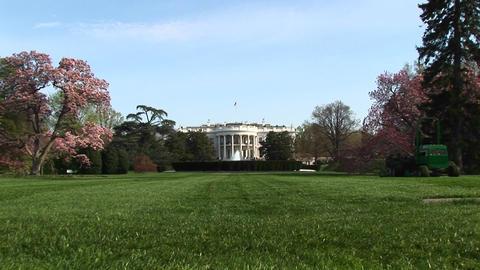 A long shot of the White House and its beautifully landscaped yard Footage